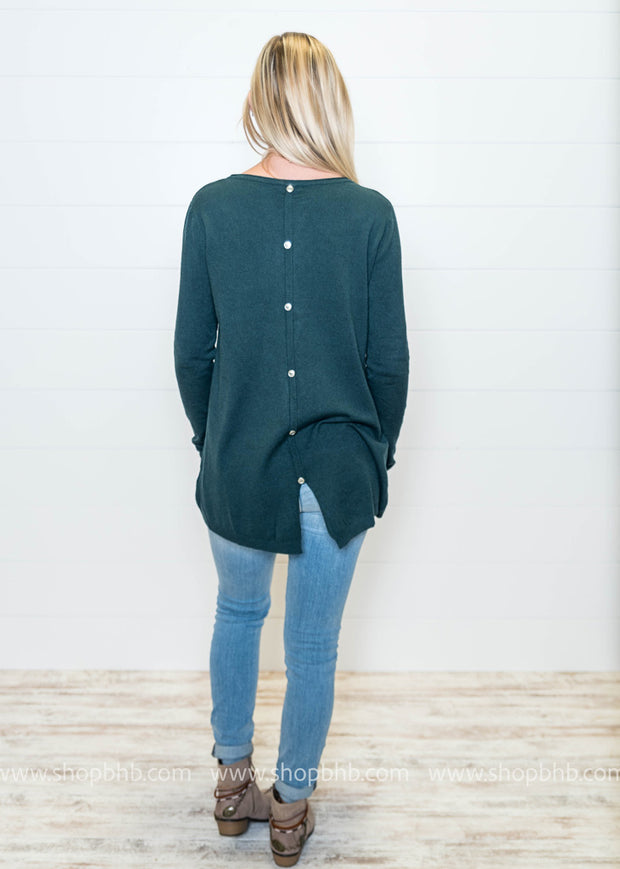 Love the button detail donw the back of this tunic sweater