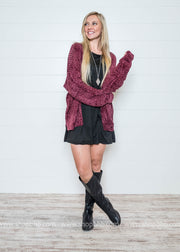 Layer up your burgundy chenille cardigan with a dress
