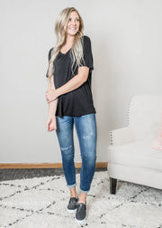 VNeck Basic t-shirt in black paired with denim and sneakers