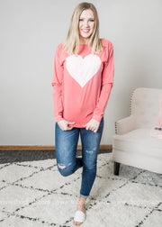 High waisted denim paired with our Long Sleeve Heart Top in faded red.
