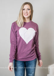 A valentines long sleeve top in faded purple adorned with a white heart.