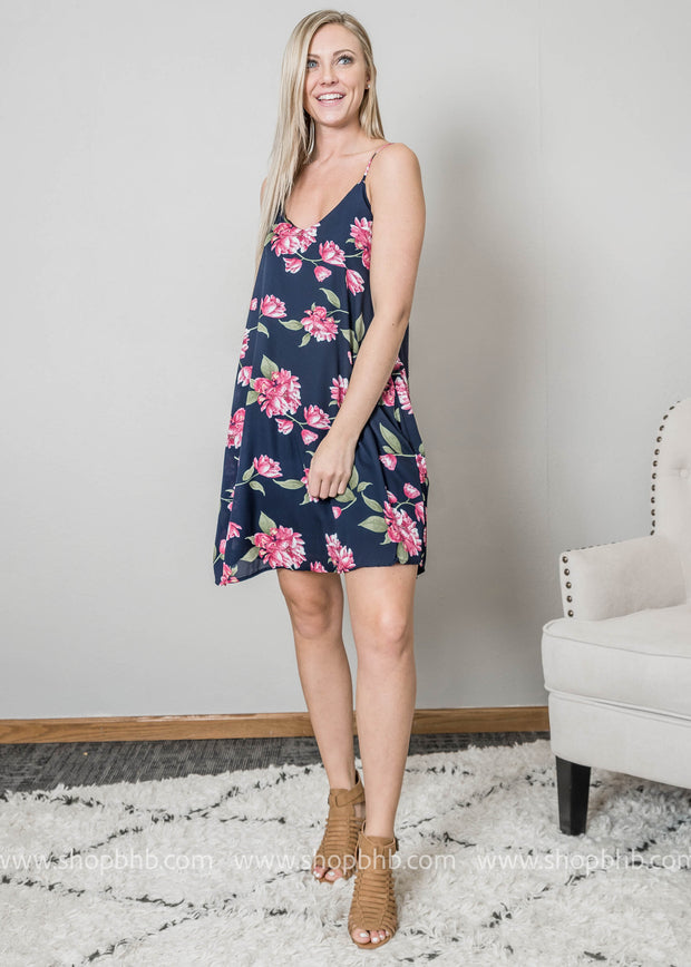 Navy slip dress with pops of fuschia flowers perfect for vacation