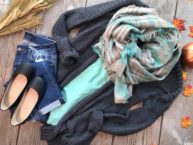 The mint plaid scarf is the perfect accessory for the cooler days.