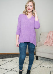 Lilac vneck sweater with hi low edging at bottom.