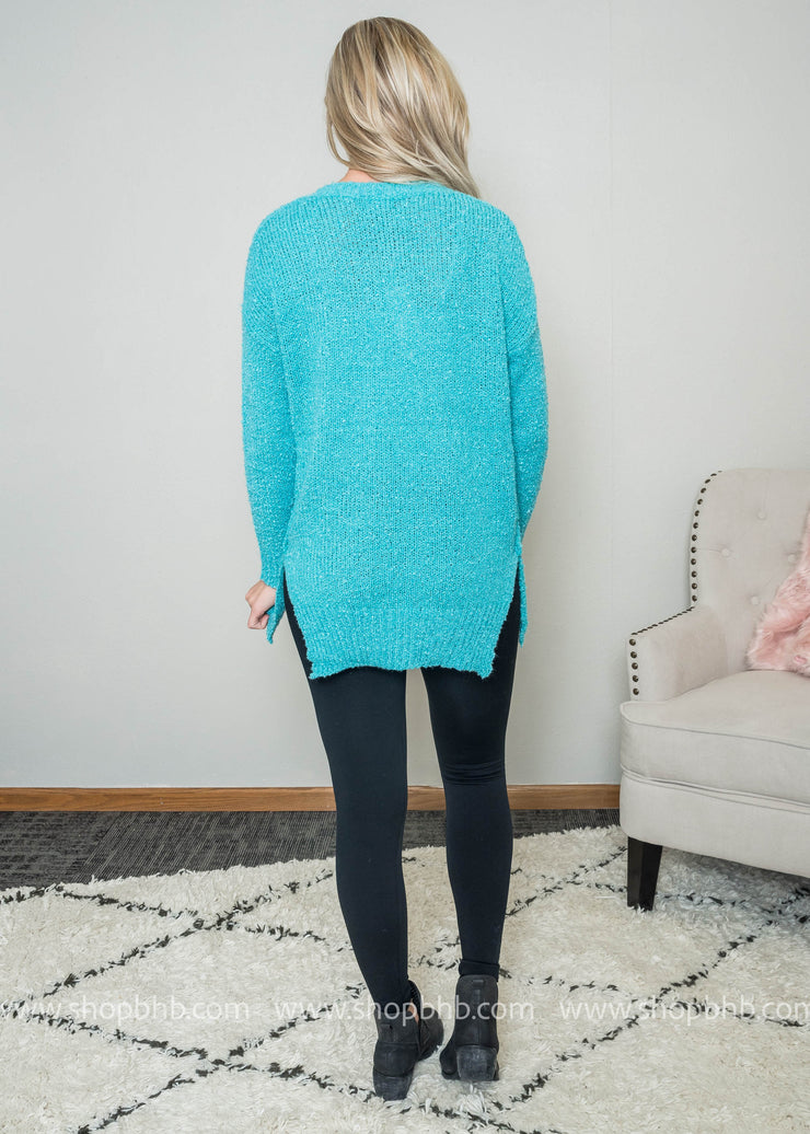 Back view of this teal sweater.