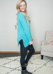 Loving the ribbed side and v-neck details of this sweater!