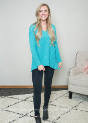 This teal buttery sweater is perfect for spring with its vibrant teal color