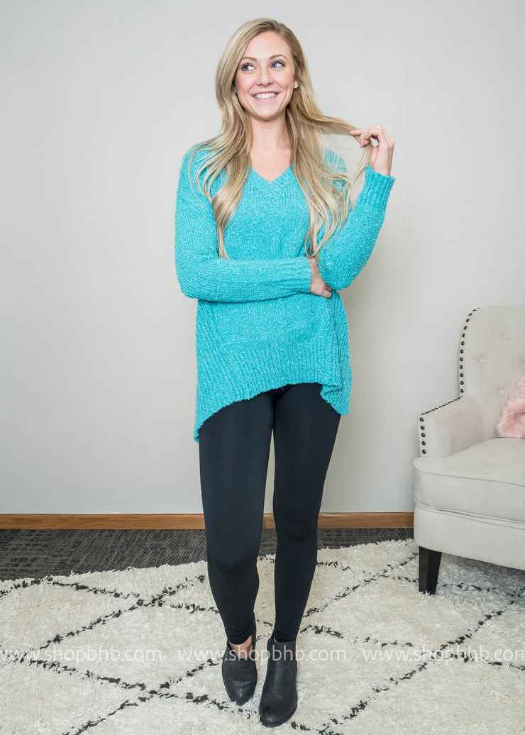 This sweater has the pops of Spring colors with the softest feel ever!