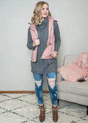This quilted hooded vest is mauve is the perfect layering piece for hitting those slopes at the ski lodge.  Vest, quilted vest, hooded vest, mauve vest