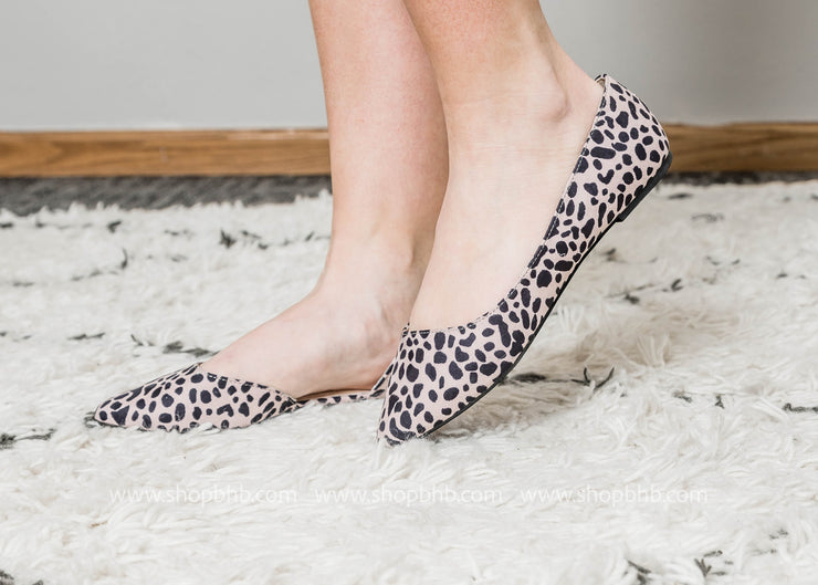 Blush leopard print ballet flat with pointed toe and side cutout.