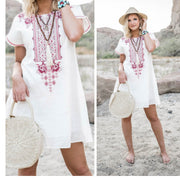 white shift dress with fuschia embroidered