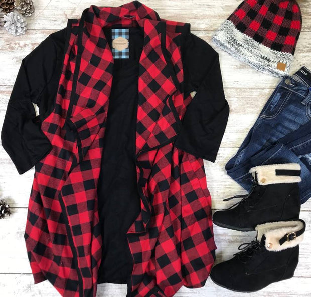 This curvy girl buffalo plaid vest has that waterfall front made with a light weight fabric.