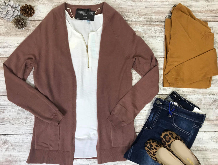 This light weight cardigan is the perfect transitional layering piece.