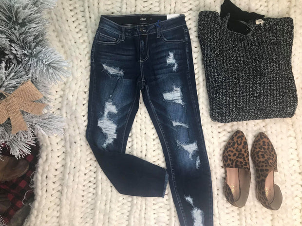 This dark denim distressed cropped skinny jeans by Cello are the perfect pair of pants to style with those booties!