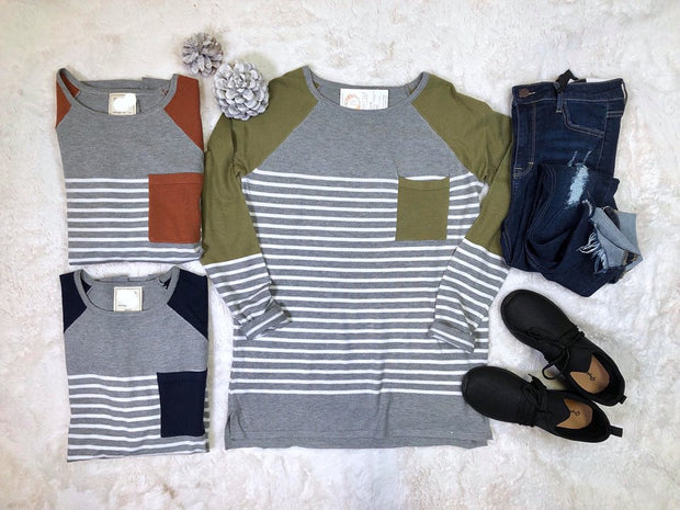 This gray quirky color block striped sweater has the perfect amount of color designed throughout.  The lightweight striped sweater is the perfect addition to a Fall Fashionista's wardrobe.