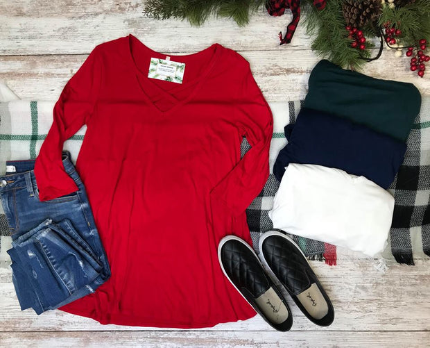This long sleeve solid criss cross detail top comes in 5 amazing colors and made with the softest fabric.  Talk about comfort in a basic top.