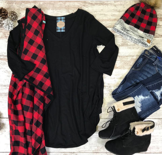 This curvy girl black v-neck tunic top is the perfect layering piece.