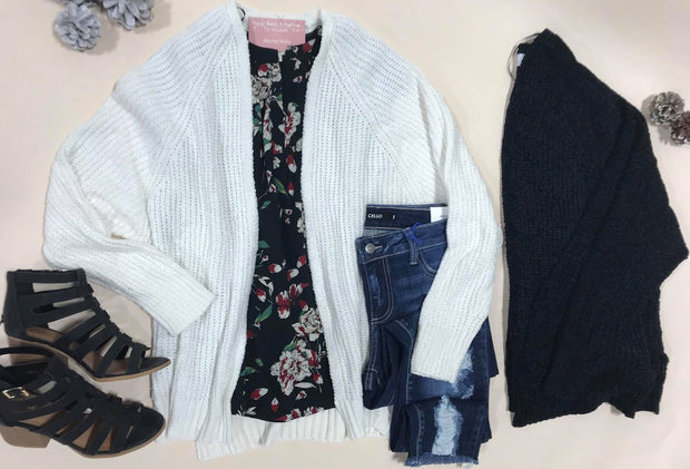 This Epic Soft Cardigan is just that!  Hits right above the belt and a perfect fit.