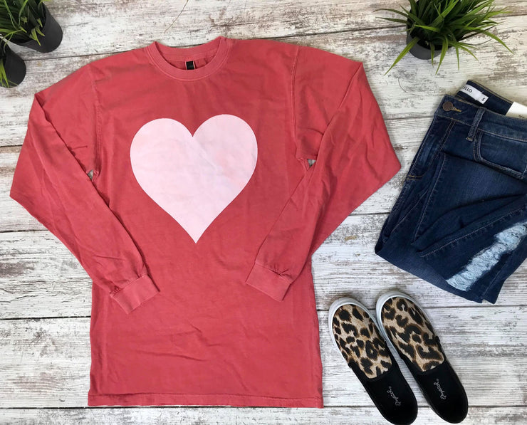 This red long sleeve top with a white heart is the stylishly way to show your love.