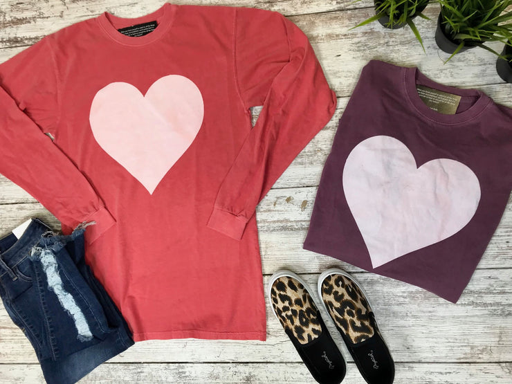 This heart top is a solid long sleeve distressed looking shirt perfect for Valentine's Day style.