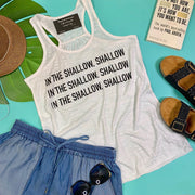 This white racer back tank, in the shallow is great for the beach day, lake day, referencing a star is born.