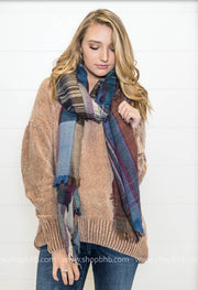 Blanket scarves are a simple way of keeping warm this winter season.