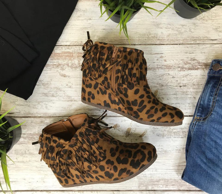 This leopard wedge bootie has that fringe details to adore that style.