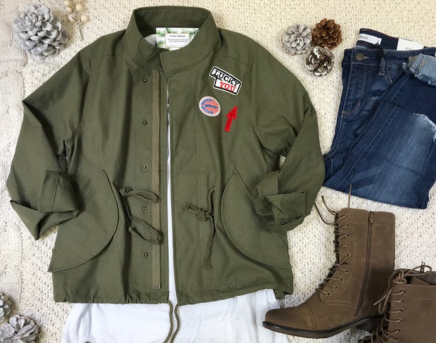 This olive military jacket add that edge of style to your wardrobe.  With zip up closure and patches ...this luck you military jacket will be a go-to favorite.