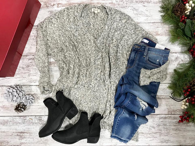 This oreo colored sweater with v-neck and high low makes this over sized sweater kind of a big deal!