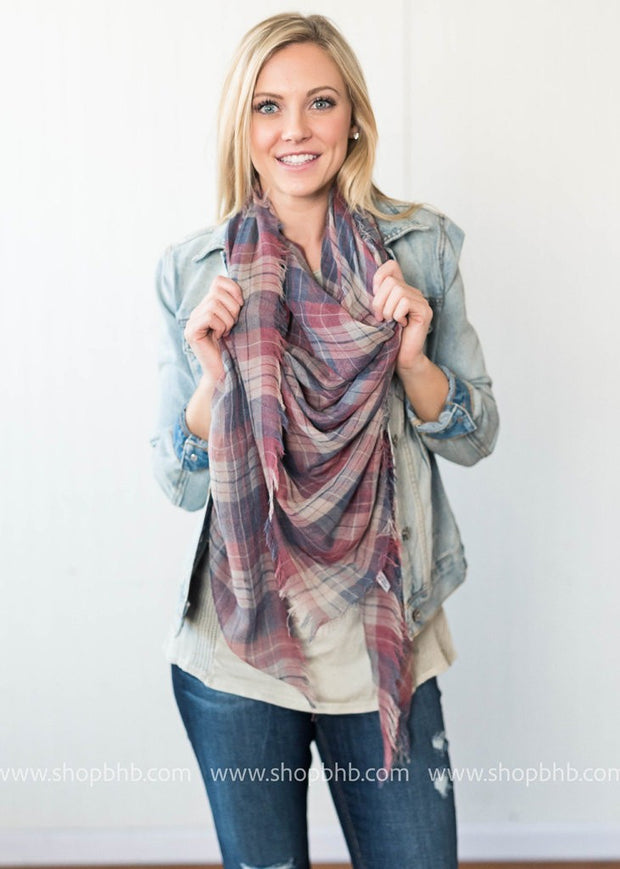 This lightweight scarf is a breezy alternative to the bulky blanket scarf.