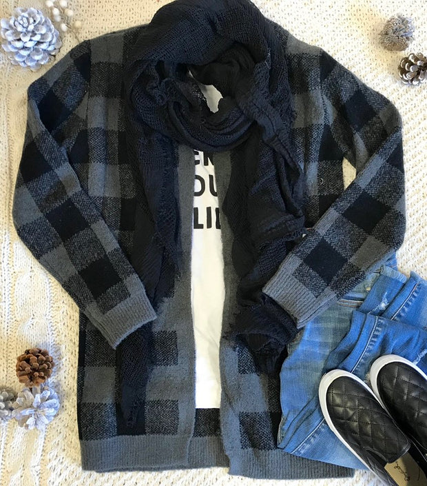 This plaid cardigan in black and charcoal is the perfect warmth for sweater weather.