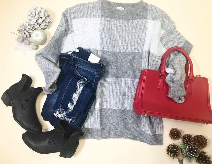 There is nothing like a cozy over size plaid sweater, pairing it with your skinny jeans or leather leggings...this is a classic sweater!