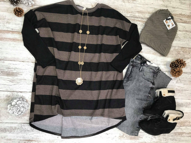 This Striped dolman top in mocha and black has this flattering fit for all your curves.