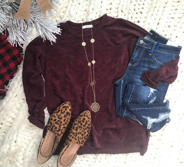 The simple things sweater has that deep beautiful burgundy color and chenille like feel.