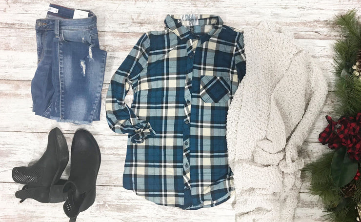 This plaid button up in teal and beige is the perfect addition to your wardrobe.