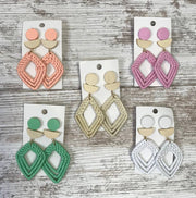 These pastel natural elements diamond shaped wicker earrings are the perfect addition to pop that color into your style.