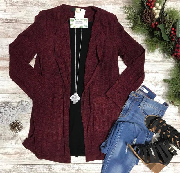 This winter wine cardigan has front pockets and ribbed texture!  Marbled with a little black...this is a classy cardigan for the office or to match your burgundy lipstick.