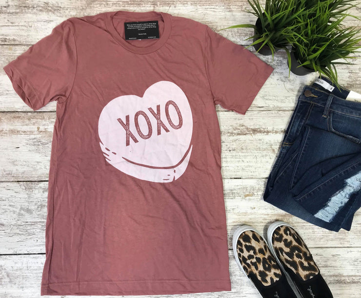 These sweetheart conversation heart saying xoxo is the perfect mauve tee to honor the absence of the brand this year.