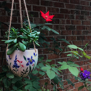 hand painted porcelain hanging pot in the garden