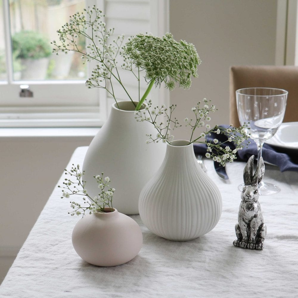 Simple ceramic bud vases styles with spring blooms