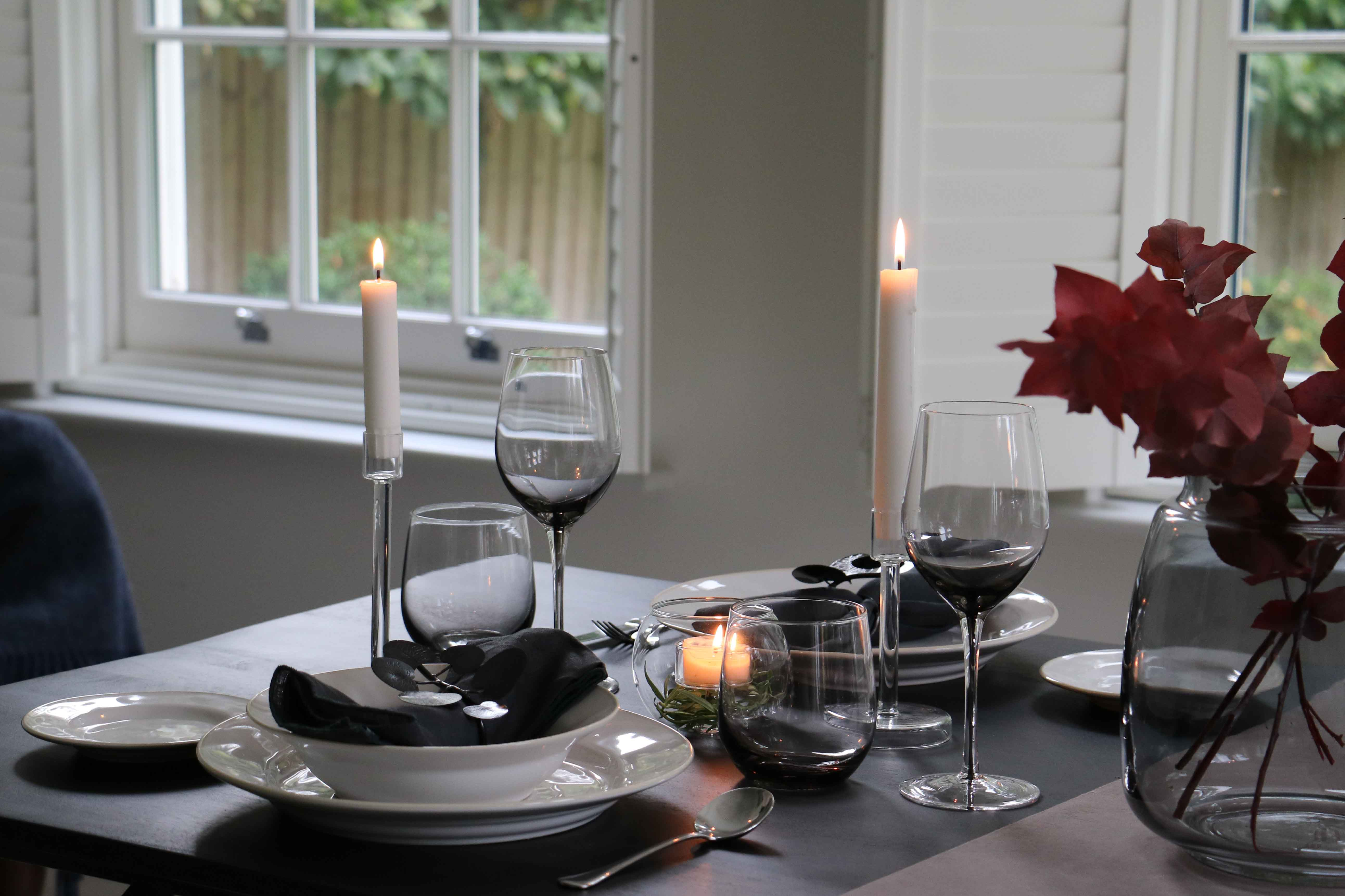 Table Setting by Layered Lounge styled with Astoria Tableware, Glass Candle Holders and Grey Glassware.
