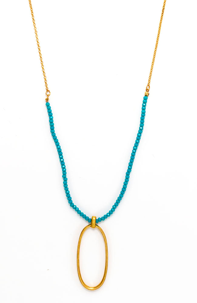 Long goldtone metal pendant with Turquiose beads