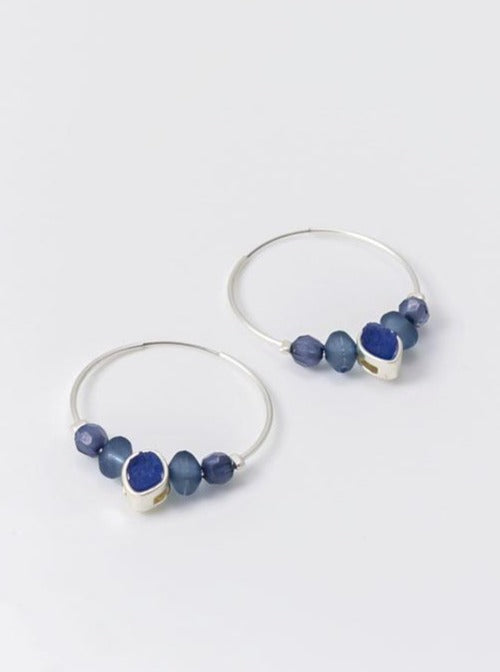 Hoop earring in silver tone