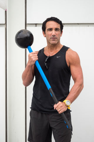 Tom Holland fitness expert with fitness sledgehammer the Core Hammer from MostFit