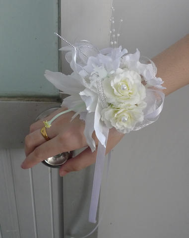 CORSAGES OF SILK WHITE ROSES WITH PEARL BRACELETS