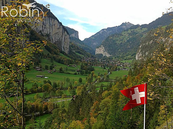 Lauterbrunnen Valley, Switzerland with Swiss flag