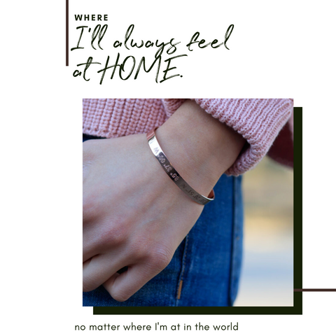 coordinates cuff bracelet in rose gold on wrist. www.latandlo.com. Coordinates of the hometown for a gift on front on bracelet.