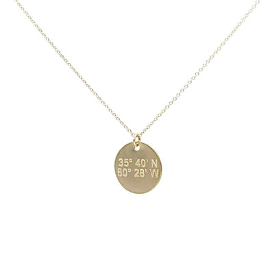 Lat & Lo disc necklace in 14K gold filled.  inscribed with custom coordinates.