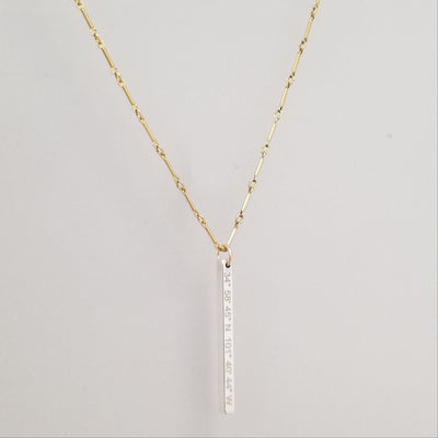 Lat & Lo Bicoastal necklace, sterling silver vertical column pendant on yellow gold filled bar and link chain, inscribed with coordinates