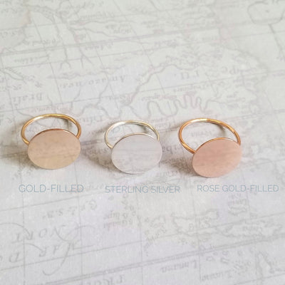Lat & Lo disc rings showing metal type options, 14K yellow and rose gold filled, sterling silver, map background